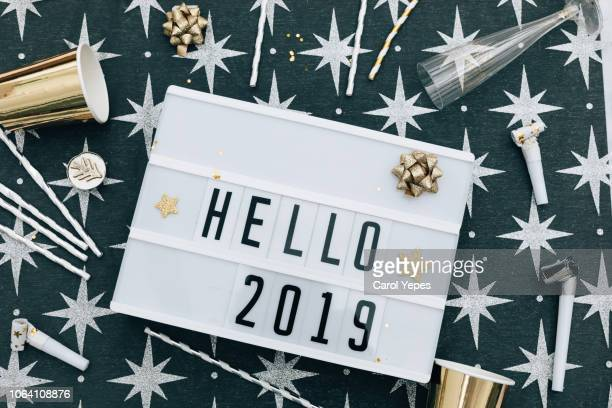 Welcome 2019 message in lightbox with silver and golden decorations