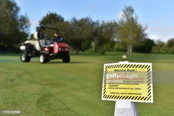 "Welcome back"" and Covid-19 safety sign as a groundsman sprays the practice putting green as golf courses reopen in England under government..."