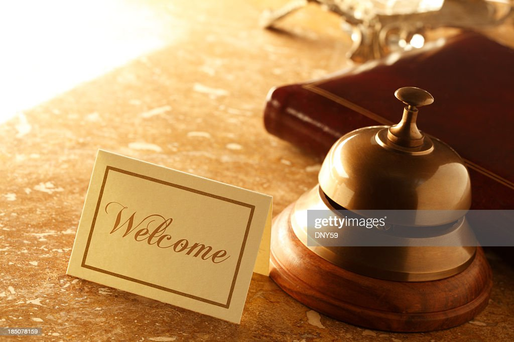 Welcome card and service bell on marble countertop in hotel : Stock Photo