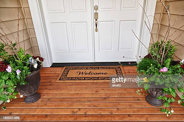 Welcome Home entrance double doorway flowers in pots