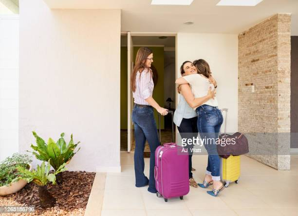 welcome hug - guest stock pictures, royalty-free photos & images