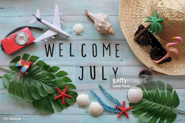 welcome july flat lay - julio fotografías e imágenes de stock