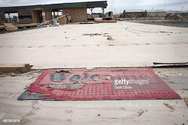 A welcome mat and foundation are all that remain of a building site which is in an area on Forward Operating Base Shank that is no longer used due to...