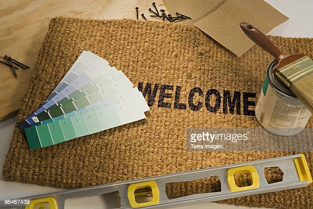 Welcome mat and paint samples