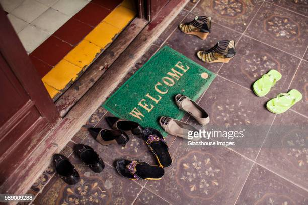 Welcome Mat and Shoes at Temple Entrance, Hanoi, Vietnam