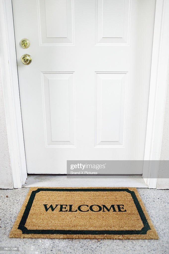 Welcome mat in doorway : Stock Photo