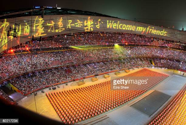 A welcome message is displayed on the stadium roof as drummers perform during the Opening Ceremony for the 2008 Beijing Summer Olympics at the...