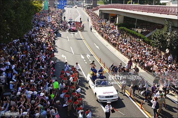 Welcome Parade Of The Space Shuttle Sts-114 Crew In Chigasaki, Japan On October 02, 2005 - The Space Shuttle Discovery STS-114 crew wave to the crowd...