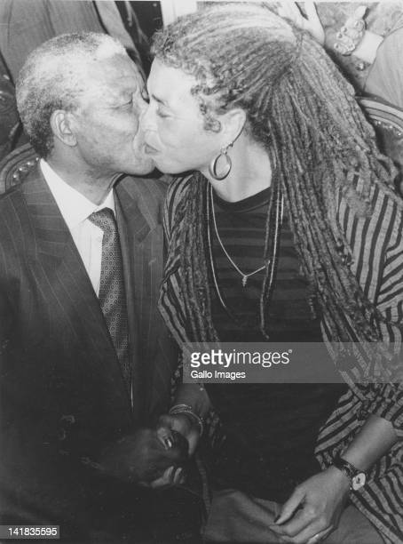 A welcome party for American communist activist Angela Davies hugged by ANC President Nelson Mandela