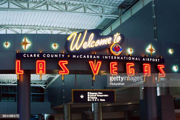 welcome sign at mccarran international airport - mccarran international airport stock photos and pictures