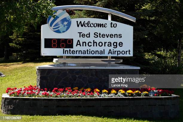A welcome sign at Ted Stevens Anchorage International Airport indicates the temperature is 86 degrees Fahrenheit at 307 pm on July 4 2019 in...
