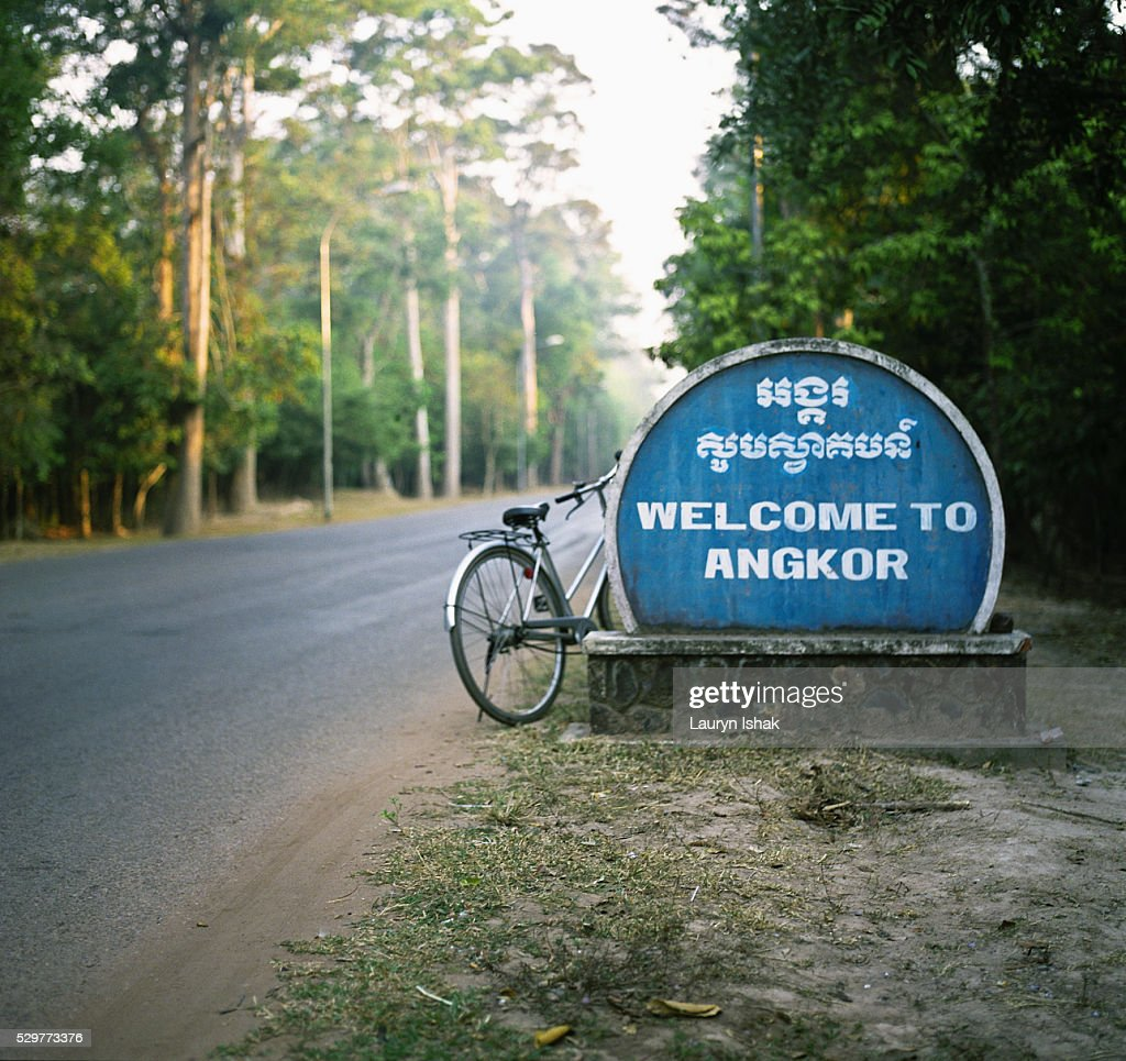 Welcome sign by road : Stock Photo