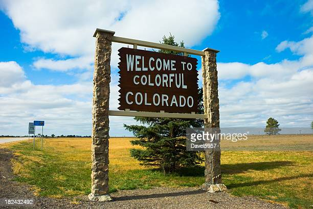 Welcome sign for Colorful Colorado on a grassy field