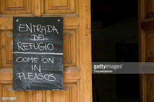 Welcome Sign on Mountain Refuge Door