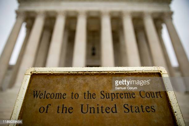 A welcome sign sits at the base of the steps to the US Supreme Court on December 16 2019 in Washington DC The Court is expected to release additional...
