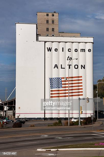 'Welcome to Alton Illinois' is painted with American flag on side of Grain Silo along the Mississippi River along the Great River Road