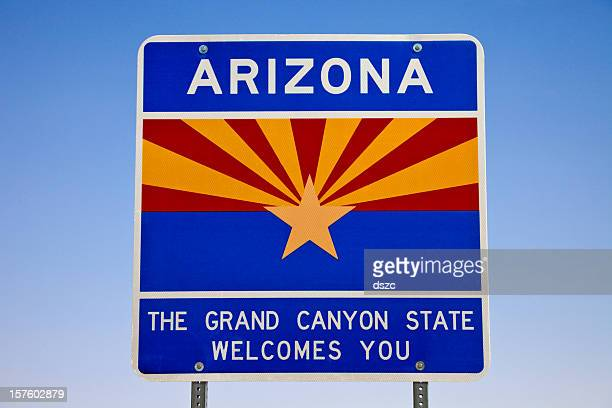 welcome to arizona sign state line - us state border stock photos and pictures