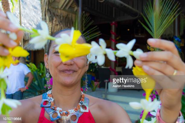 welcome to bora bora with a lei - polynesia stock pictures, royalty-free photos & images