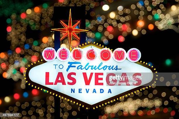 Welcome to Fabulous Las Vegas sign with colorful blurry lights in the back.
