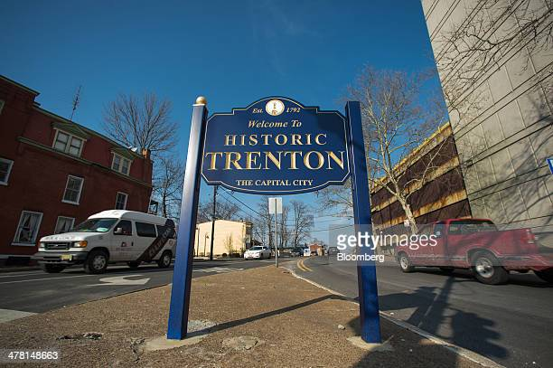 A Welcome to Historic Trenton sign stands at an intersection in Trenton New Jersey US on Tuesday March 11 2014 New Jersey's pension system is...