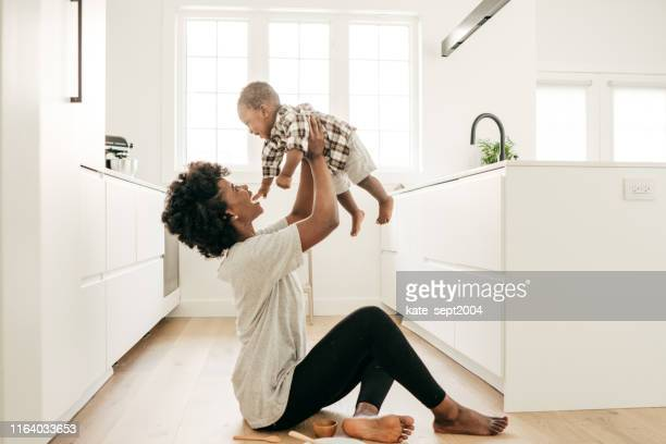 welcome to motherhood - innocence stock pictures, royalty-free photos & images
