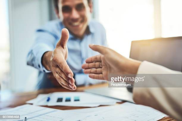 welcome to our company - hand shaking hands stock pictures, royalty-free photos & images