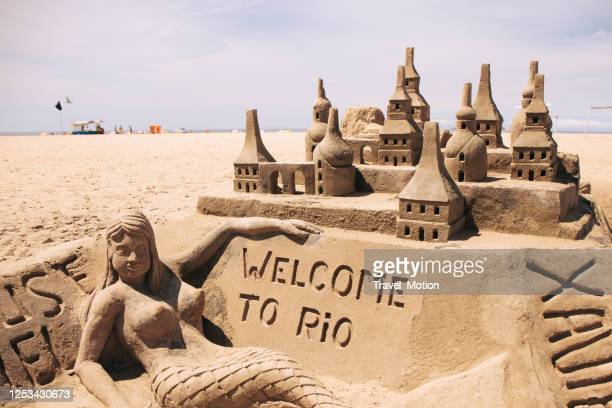 welcome to rio sand castle on copacabana beach in rio de janeiro - large breasts stock pictures, royalty-free photos & images