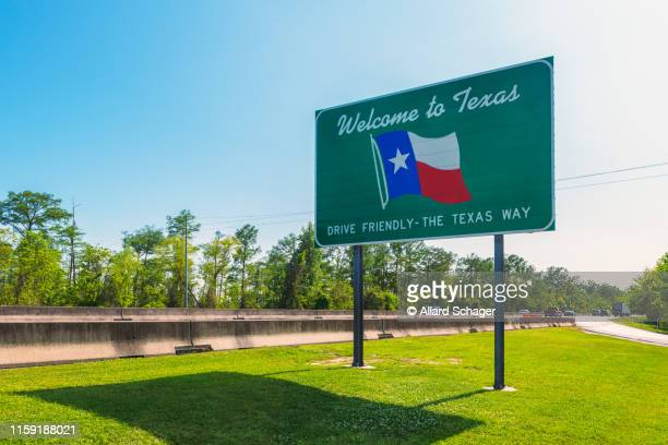 welcome to texas sign - us state border stock photos and pictures