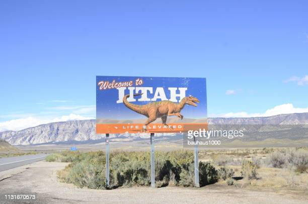 welcome to utah sign - us state border stock photos and pictures