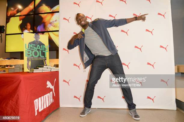 """Welcomes Usain Bolt for a book signing of his autobiography """"Faster Than Lightning"""" at The PUMA Store in Santa Monica at Puma on November 19, 2013 in..."""