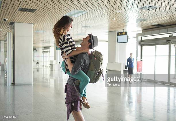 Welcoming boyfriend at the airport.