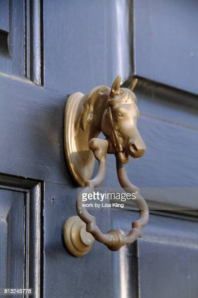 welcoming brass horse door knocker - door knocker stock photos and pictures