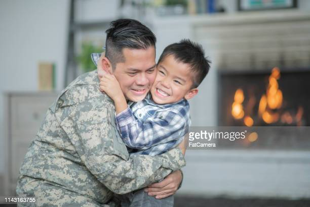 welcoming dad home - filipino family reunion stock pictures, royalty-free photos & images