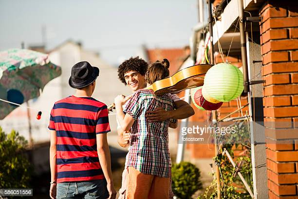 welcoming  friends for rooftop party - welcoming guests stock photos and pictures