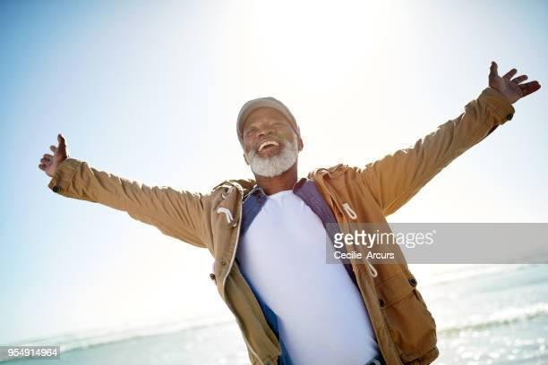 welcoming the sunny side of retirement - arms outstretched stock pictures, royalty-free photos & images