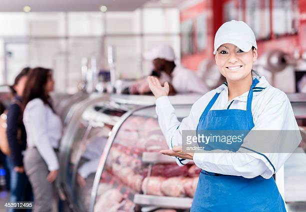 Welcoming woman butcher
