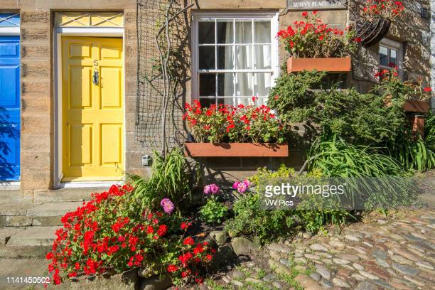 Welcoming yellow door Robin Hoods Bay Yorkshire UK