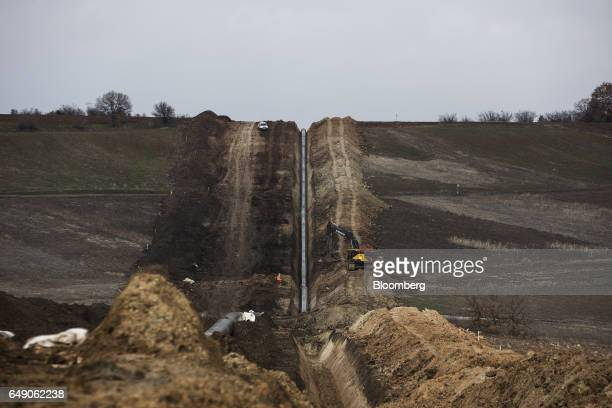 Welded pipes sit in a trench on a hillside at the 685km point during the construction of the Trans Adriatic gas pipeline in Chamilo Greece on...