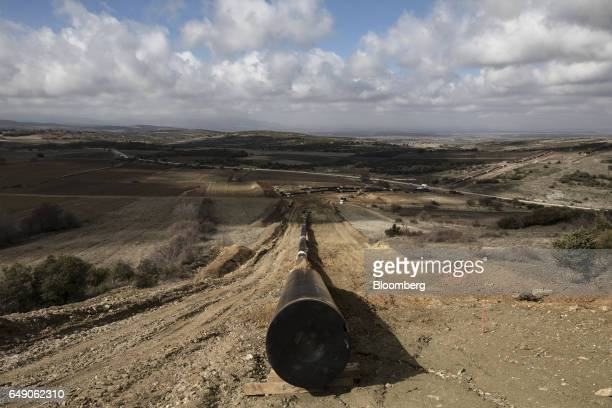 Welded pipes sits on the ground at the 63km point during the construction of the Trans Adriatic gas pipeline in Sikorachi Greece on Thursday Feb 23...