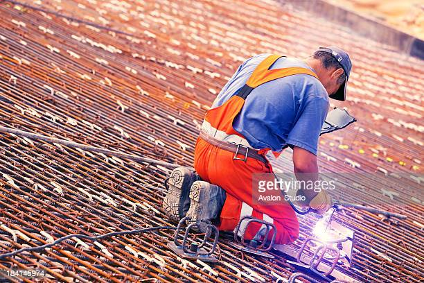 welder and concrete reinforcement - metallic shoe stock pictures, royalty-free photos & images