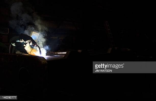 A welder at Specialty Fab Inc in North Lima Ohio works on a piece of a compressor skid frame on March 1 which is bound for the Ohio Shale project...