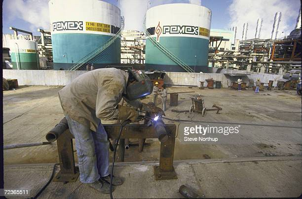 Welder at work at Pemex oil refinery