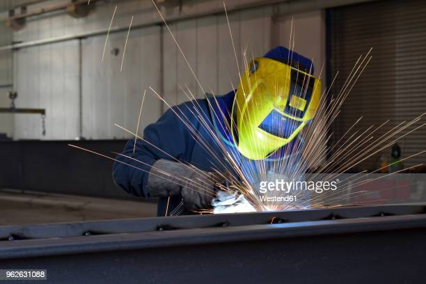 welder at work in factory - welding stock photos and pictures