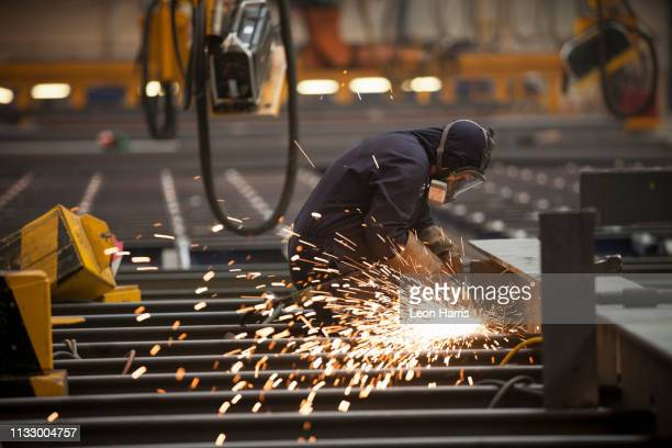 welder at work in shipyard - shipyard stock pictures, royalty-free photos & images