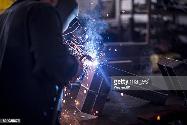 Welder at work in workshop
