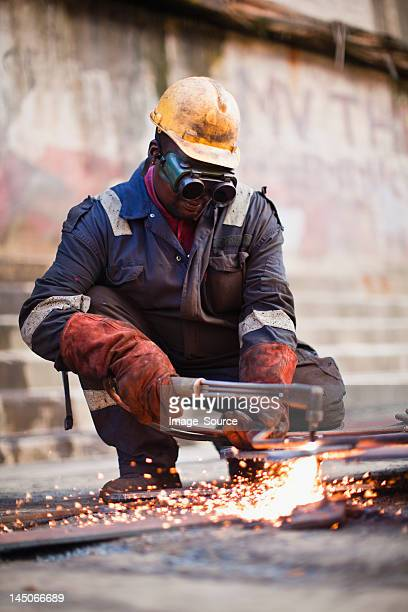 Welder at work on dry dock