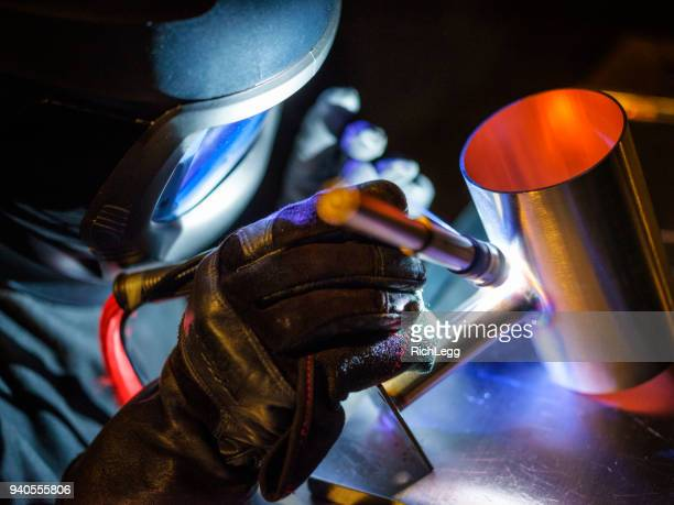 tig welder at work - welding stock photos and pictures
