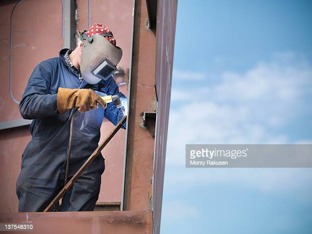 Welder building ship