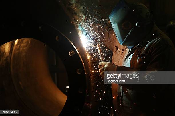 A welder for Stewarts Inc an oilfield service company works on a tank that will be used in the fracking industry in the Permian Basin oil field on...