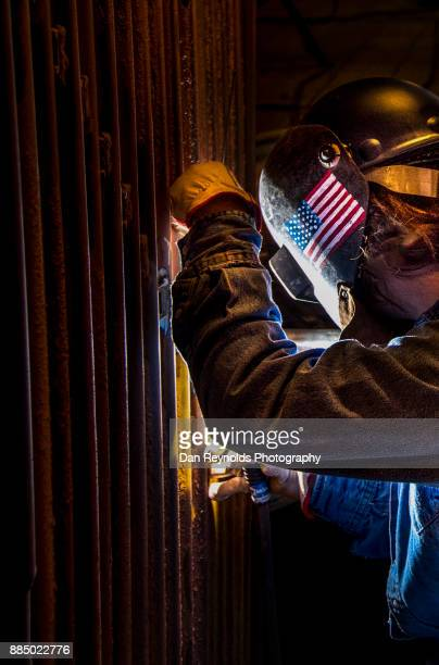 welder in mask while working - in flames i the mask stock pictures, royalty-free photos & images